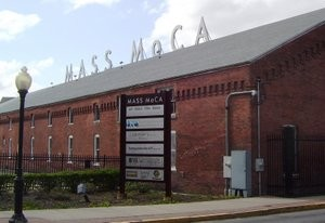 exterior view of Mass MoCA and sign