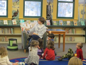 Children's Librarian Miss Kim in the Children's Room at Lilly Library reading a picture book to preschoolers during storytime