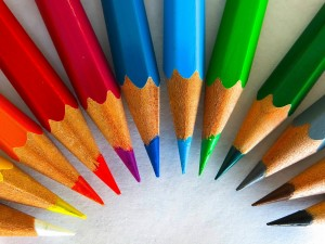 Semi-circle of colored pencils - white, yellow, orange, red, violet, blue, light blue, light green, green, gray, brown, black